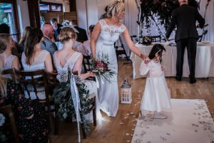 December wedding flowers aisle swags and hanging centrepieces